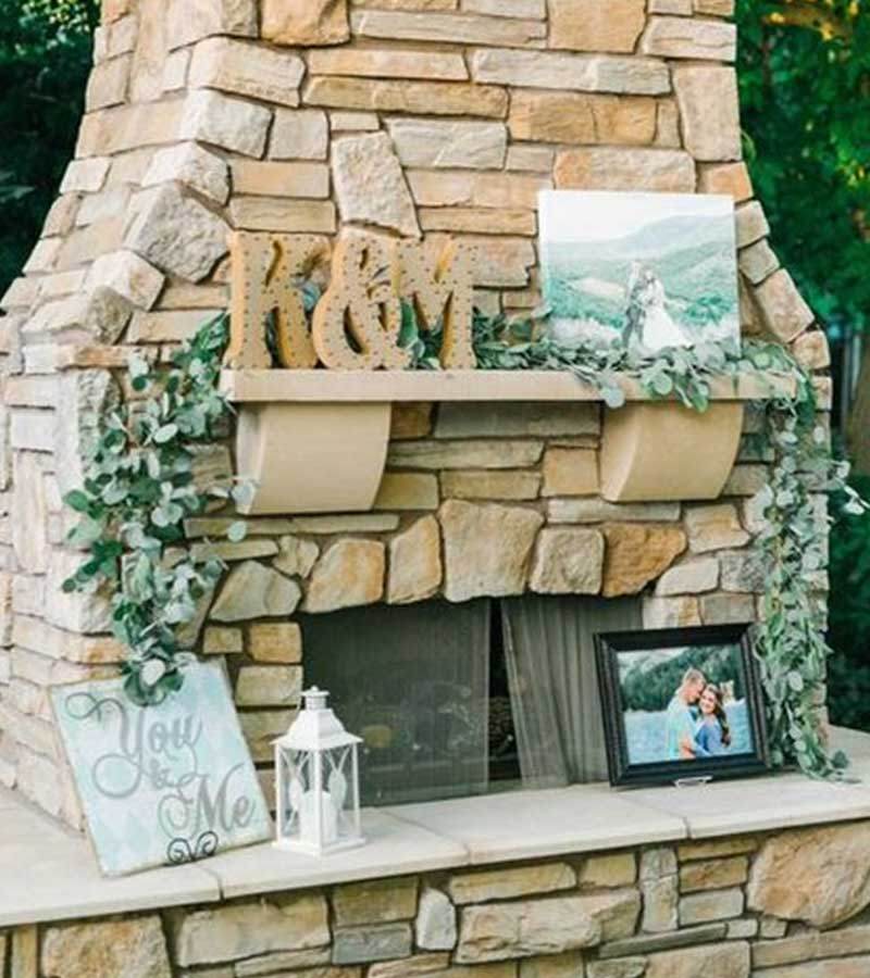 Canvas and photos decorate stone fireplace
