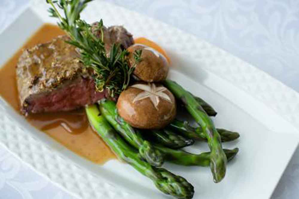 Beef with vegetables and potatoes by culinary catering