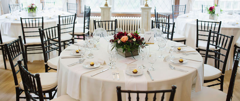 Wedding table setting with black chairs by Raw Footage