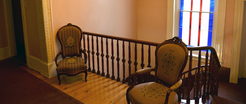 Arm chairs at the top fo the stairs by Dean Archer