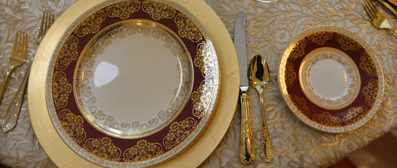 Red and gold ornamental table setting by Dean Archer